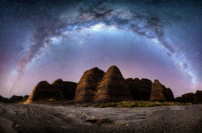 The Milky Way arches over the Beehive domes in Purnululu National Park .The night sky in Outback Australia.