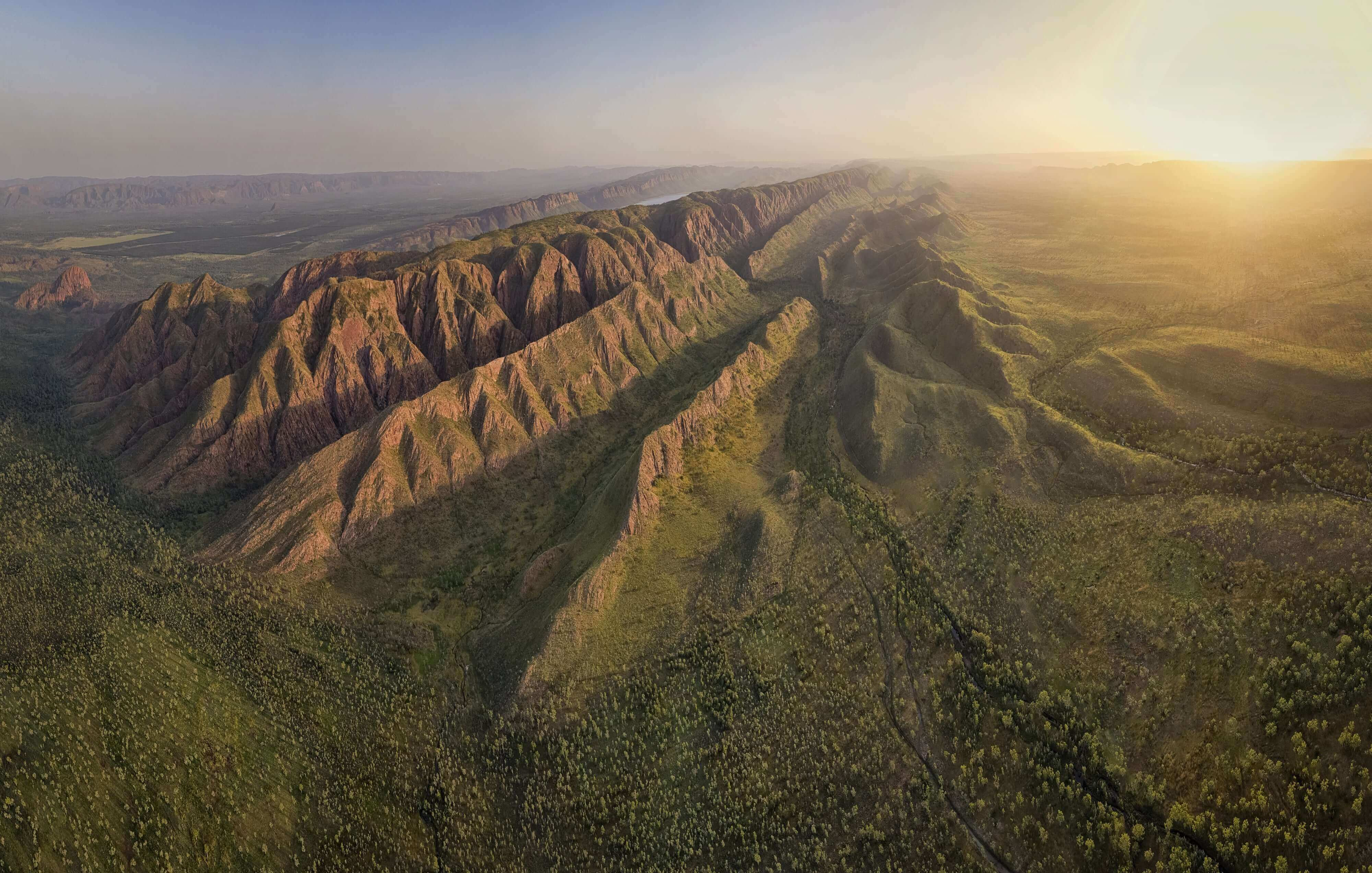 Drone shot of Outback Australia. Saw Ranges. Aptly named for how they resemble the teeth of a saw blade. Nestled in these stunning ranges is Wuggabun community, where many of its residents I went to school with in Wyndham in its hay day.